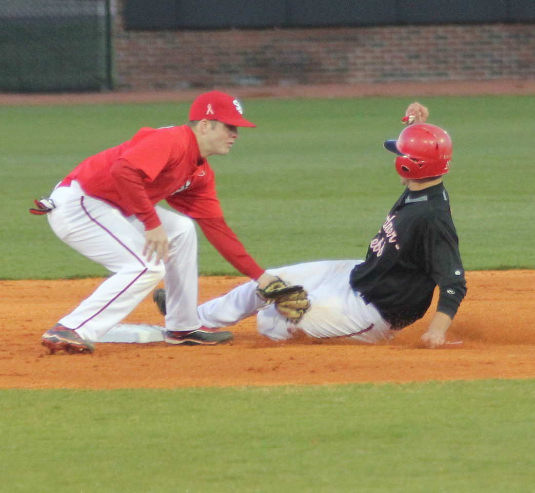 Third Baseman Scott Coleman attempts a steal against the Red Storm.