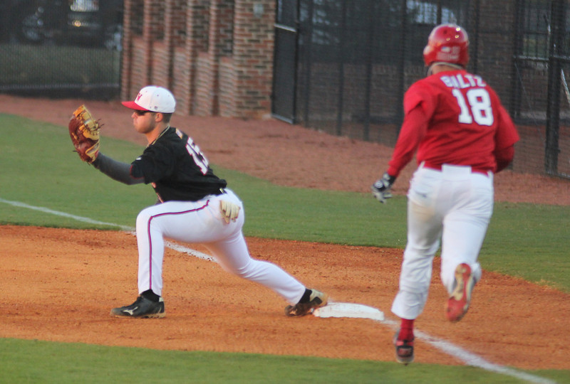 #15 Dusty Quattlebaum receives the ball for an out against St. John's on Friday March 11th 2011.