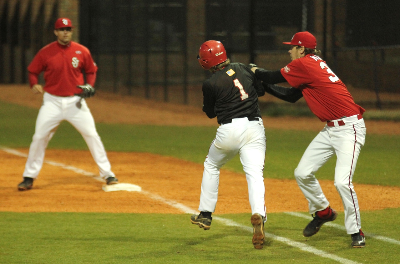 #1 Daniel Merck is thrown out while attempting to run to first base on Friday March 11th, 2011.