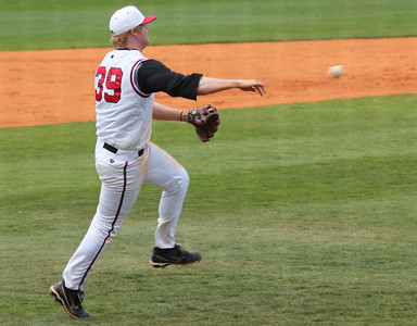 #39 Brad Collins attempts to throw out a runner at first base during the second of three games against UNC-Asheville.