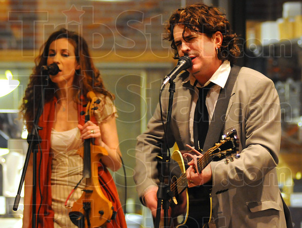"""Tribune-Star/Jim Avelis<br /> Helping hand: Michael McDermott and his wife Heather Orton provided the music at the launch of his brand of gourmet coffee """"Legendary"""" at Clabber Girl Thursday night."""