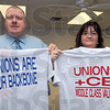 Tribune-Star/Jim Avelis<br /> Clear message: Shane Grimes, Indiana State Teachers Association Uniserve Director, and Cindy Stewart of the ISTA hold two of the three printed t-shirts they are making available.