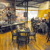 "Tribune-Star/Jim Avelis<br /> Helping hand: Michael McDermott and his wife Heather Orton provided the music at the launch of his brand of gourmet coffee ""Legendary"" at Clabber Girl Thursday night."