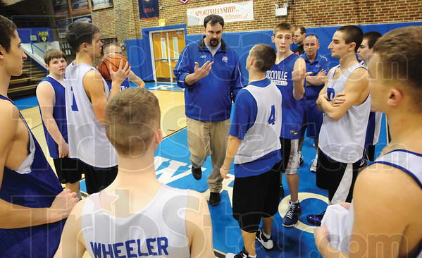 Tribune-Star/Rachel Keyes<br /> Food for thought: Coach Mahurin gives his team some key things to think about in practice Thursday while preparing for the semi-state game on Saturday.