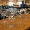 Auction items: Glasses sit on the bar of the Sycamore Hills Golf Club for auction Thursday afternoon.