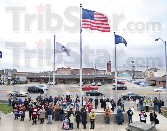 Tribune-Star/Rachel Keyes<br /> Middle class rally: Over a hundred people gathered in protest of a sweeping package of bills in the General Assembly targeting the middle class living standards and public education.