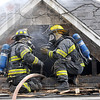 Fire scene: Two Terre Haute firefighters communicate while fighting a fire at 3007 South 11 1/2 Street Thursday morning.