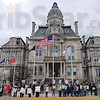 Tribune-Star/Rachel Keyes<br /> Speaking out: Over a hundred people gathered on the courthouse steps for a rally to support the middle class Thursday evening.