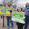 Tribune-Star/Rachel Keyes<br /> Family matter: Scott Dillion, (left) Lanne Dillion (middle) and Greg Dillion (right) came out to protest they come from a family of teachers parents are both retired teachers.