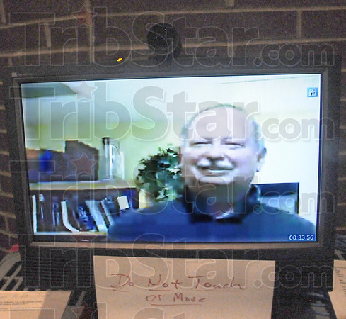 Link: Dr. Randy Stevens appears on a laptop connected to the North High School  auditorium Thursday afternoon.
