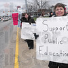 Tribune-Star/Rachel Keyes<br /> Stand up!: Educational Assistant Judy Phillips braves the cold weather to stand up for teachers and middle class workers in at a rally held Thursday at the Vigo County Court House.
