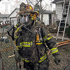 Soot suit: A Terre Haute fire department Captain emerges from a burning home at 3007 South 11 1/2 Street Thursday morning.