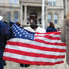 Tribune-Star/Rachel Keyes<br /> Patriots: Protesters at a rally for the middle class hold up an American Flag.