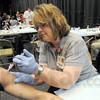Shot: Dena Cochran immunizes a Terre Haute North student during Thursday's clinic event at the school.