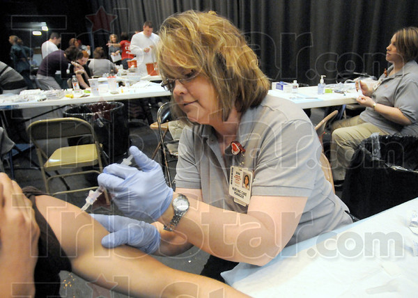 Shot: Dena Cochran immunizes a Terre Haute North student during Thursday's clinic event at the school.