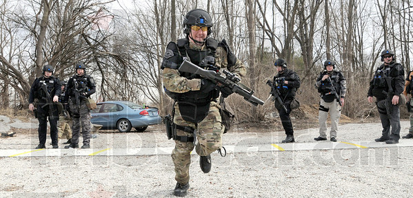 Run and gun: Sgt. Mike Ellerman runs to get into firing position during a SWAT team training event Thursday afternoon at the THPD firing range.