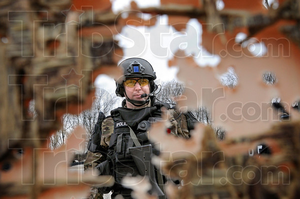Shredded: Sgt. Mike Ellerman looks at his shredded target during a swat team live firing exercise Thursday afternoon at the THPD firing range.