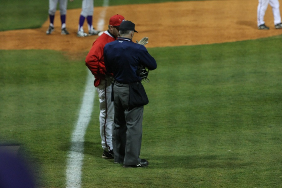 Coach discusses a call with the umpire.