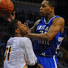 Agressive offense: Sycamore Dwayne Lathan drives the lane for a shot, getting charged for a foul on Shocker J.T. Durley.