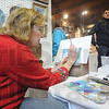 Tribune-Star/Rachel Keyes<br /> Art in the making: Artist Connie Wasson works while customers come in and out of her booth at the Maple Syrup Festival.