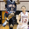Drive: North's #11, Tommie Bolden drives the ball down the lane in the first quarter of play against Plainfield Saturday night enroute to a sectional championship win.