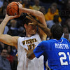 In your face defense: Isiah Martin gets up close with his defense of ShockerGarett Stutz.