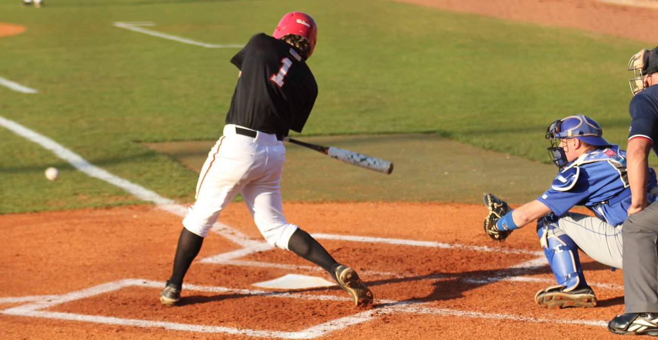 #1 Daniel Merck anticipates a pitch in the first of three games in the weekend series against UNC-Asheville.