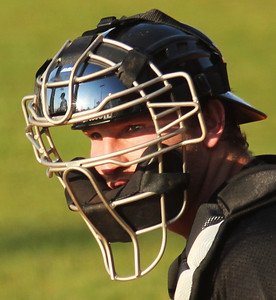 Catcher John Harris awaits a pitch call from Coach Rusty Stroupe on March 18th, 2011.