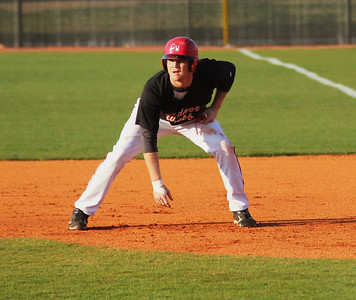#26 Jake Watts lands on first base, and attempts to steal in Gardner-Webb's match-up against the Bulldogs of UNC-Asheville on Friday night.