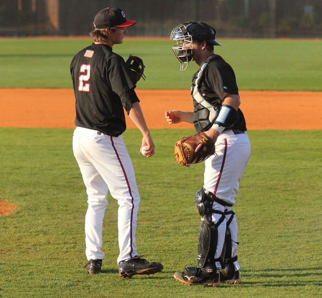 Brandon Boling (L) and John Harris (R) have a meeting during the 'Dogs game against UNC-Asheville.
