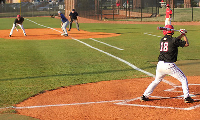 #18 Scott Coleman is up to bat as Jake Watts attempts to steal first base early in Gardner-Webb's game against Asheville.