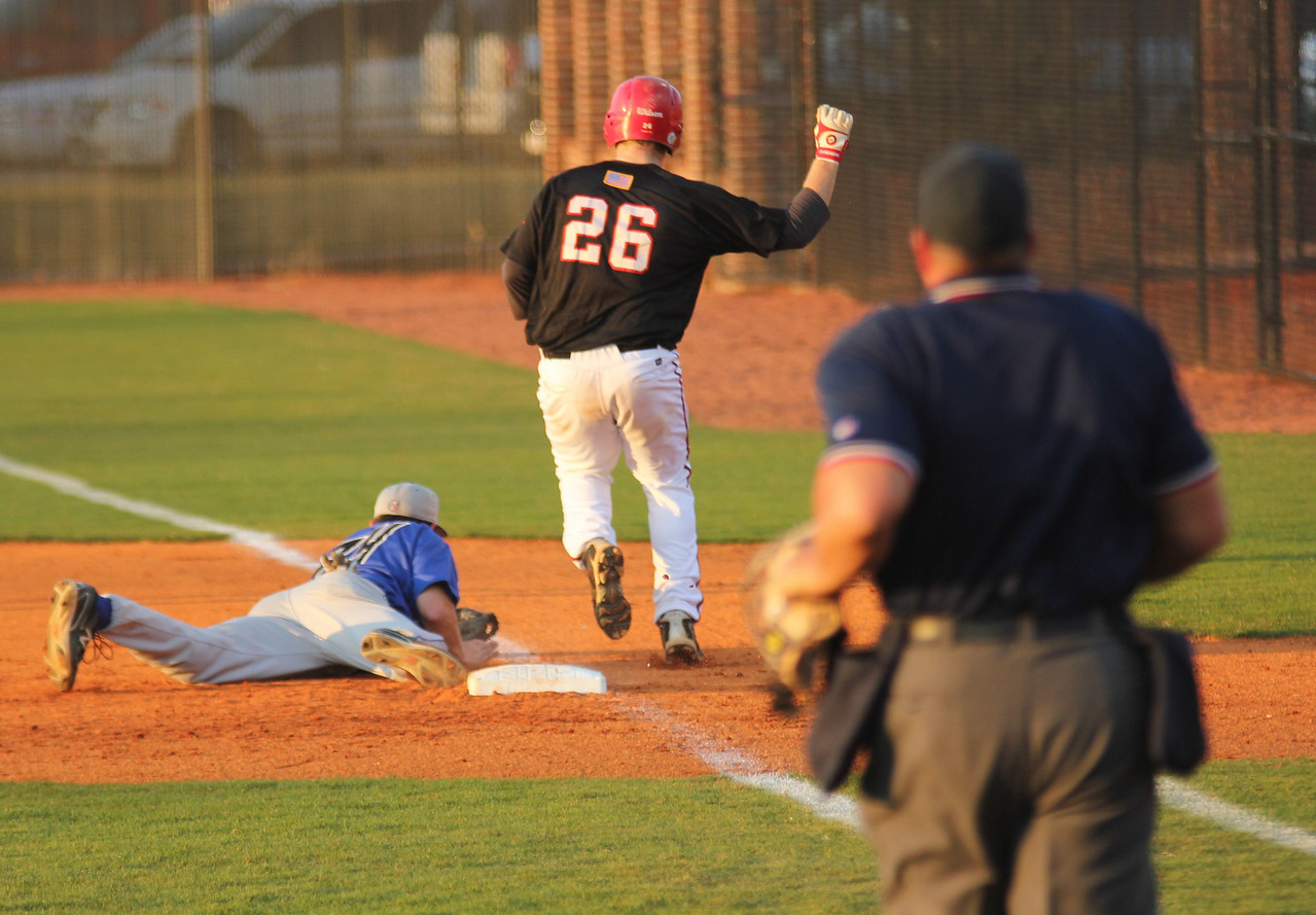 #26 Jake Watts gets called out at first base early in GWU's match against UNC-Asheville.