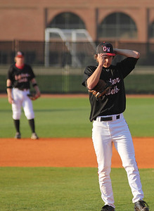 Pitcher Brandon Boling adjusts his hat on Friday night.