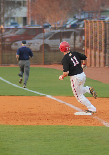 #11 Zeke Blanton reaches first base after a smash hit to right field on March 18th, 2011.