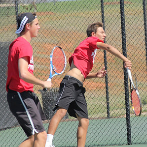 Roman Piftor serves in his doubles match on Saturday alongside partner Julien Belair.