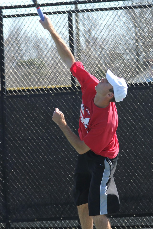 Andrew Carter practices his serve before his match against Georgia State.