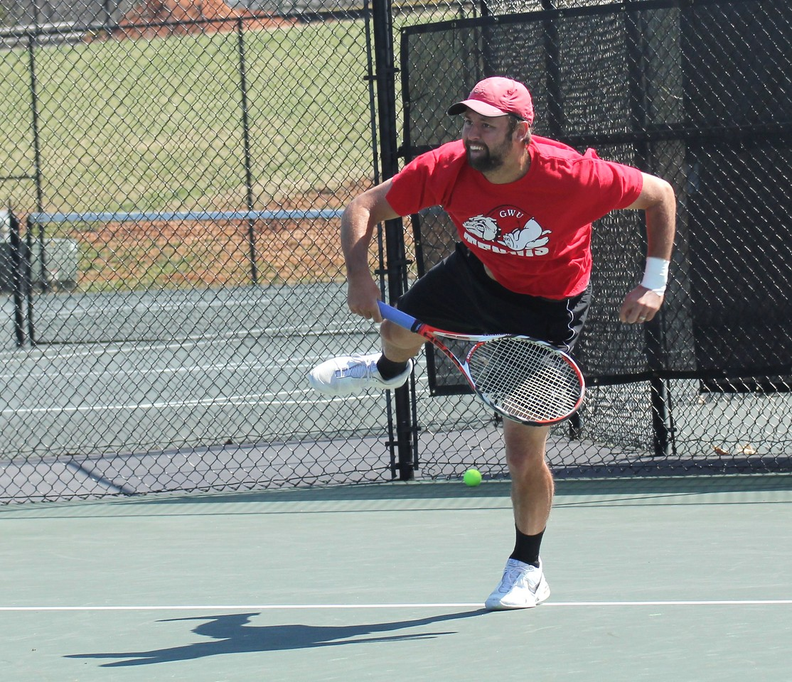Andrew Veeder serves during his match against Georgia State.