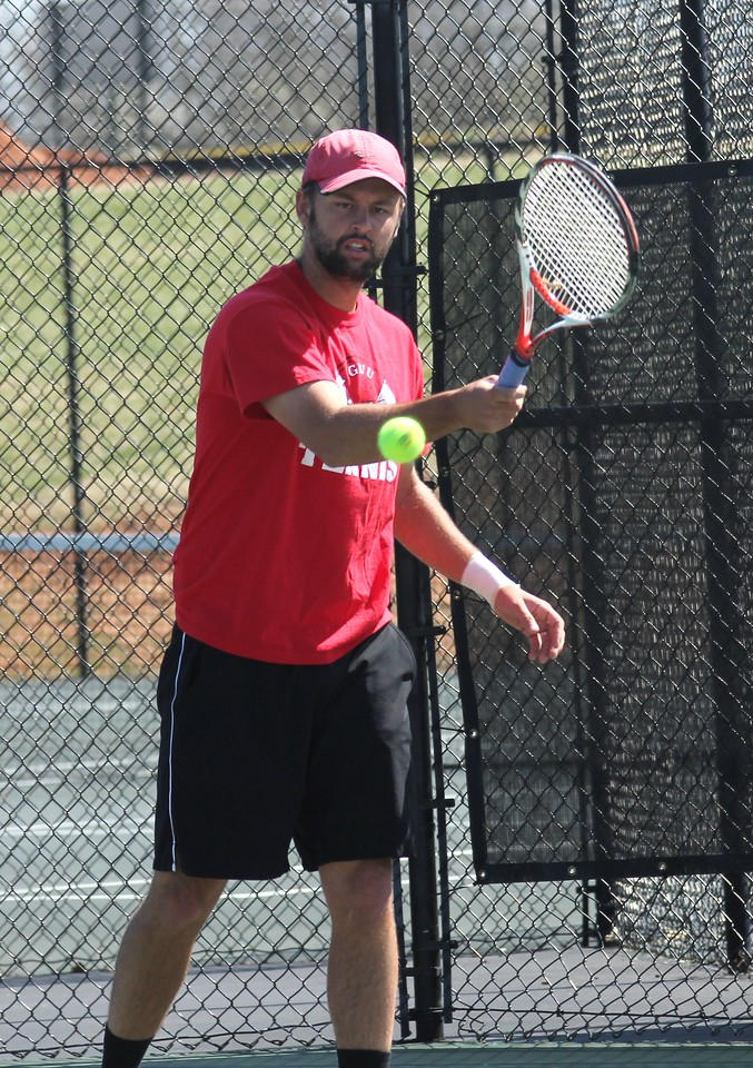 Andrew Veeder practices before his doubles match on March 12th, 2011.