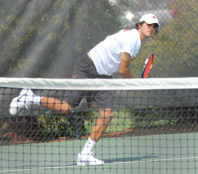 Korhan Ates prepares to return a ball to a Pfeiffer University opponent.