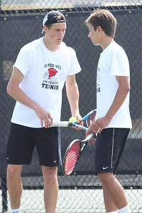 Julien Belair (L) and Roman Piftor (R) team up against the Pfeiffer Falcons.