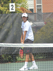 Korhan Ates serves to a member of the Pfeiffer University team in his singles match on March 19th, 2011.