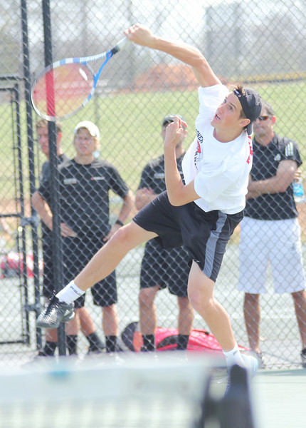 Julien Belair serves against a member of the Falcon squad.