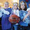 """Tribune-Star/Rachel Keyes<br /> Sycamore angels: Madi Halls (left) Caroline Davies (middle) and Megan Rader (right) the self dubbed """"Sycamore Angels"""" strike a pose for the camera the three are neighbors and big Jake Kelly fans."""