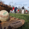 Tribune-Star/Jim Avelis<br /> Springs fever: A ball and glove lay ready for action as soon as the Rose-Hulmaqn baseball team gets warmed up on a chilly Friday afternoon.