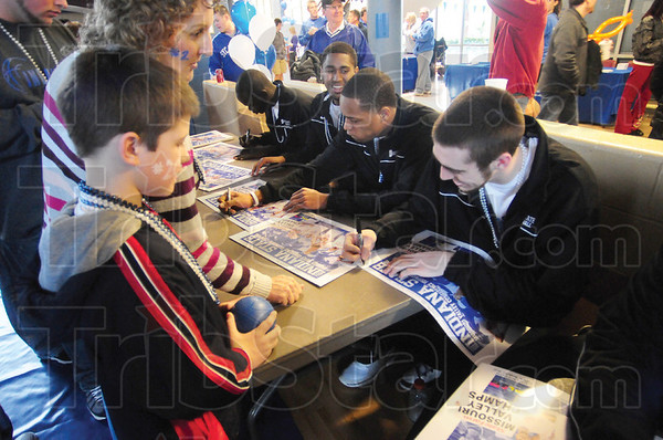 Tribune-Star/Rachel Keyes<br /> In awe: Seven-year-old Indiana State fan Rylan Schneider (left) get an autograph from Jake Odum (right) Rylan made to St. Louis to watch his team win the MVC Championship.
