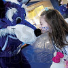 Tribune-Star/Rachel Keyes<br /> Young love: Sycamore Sam gets some sugar from future cheerleader Katlyn Bowman.