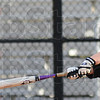 Tribune-Star/Jim Avelis<br /> Swing away: Allison Bowman connects on a line drive during softball practice Friday afternoon at Rose-Hulman.