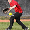 Tribune-Star/Jim Avelis<br /> Sign of Spring: RHIT softball player Molly Richardson snares a ball durng batting and fielding practice Friday afternoon.