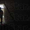 Tribune-Star/Rachel Keyes<br /> Light in sight: A Teen Challenge student walks down the stairs of the facility. Many see Teen Challenge as their last chance to get it right.