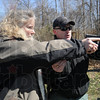 Tribune-Star/Rachel Keyes<br /> Instruction: Lisa Trigg (left) gets some gets some careful instruction from Jason Frazier before shooting a round into a target.